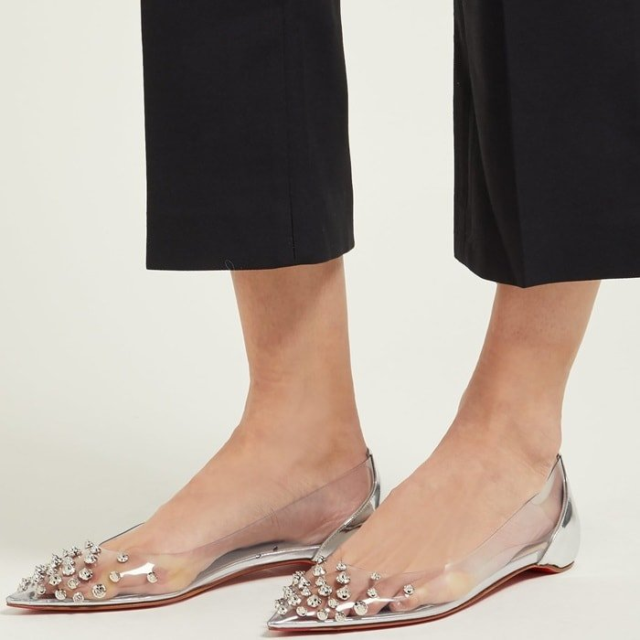 Christian Louboutin's point-toe pair has mirrored-leather across the heel to match the sparkling silver spikes