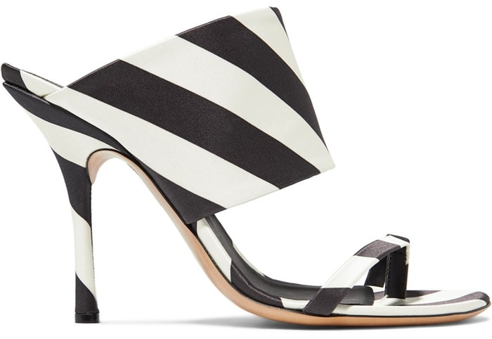These graphic striped mules are made from lustrous monochrome satin and rest on slim stiletto heels