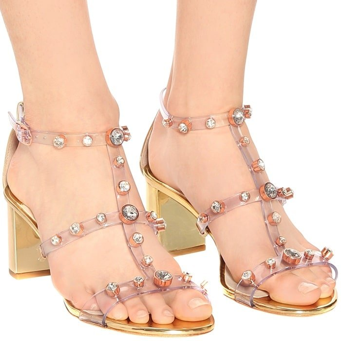 These gold sandals have clear PVC straps punctuated with crystals and are set on chunky gold leather heels