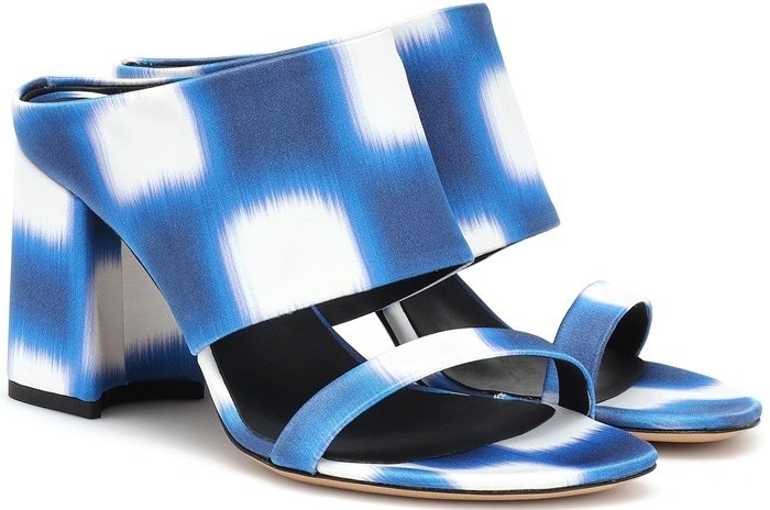 A graphic blue and white motif is expertly displayed across the artful Italian-made design, which compromises of a block heel and two front straps in varying degrees of width