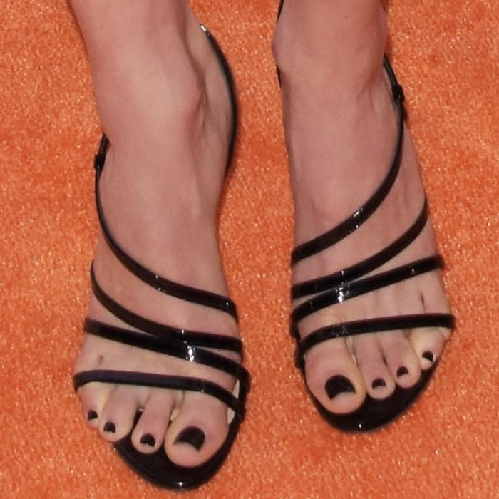 Emmy Rossum's messed up toes in strappy black sandals