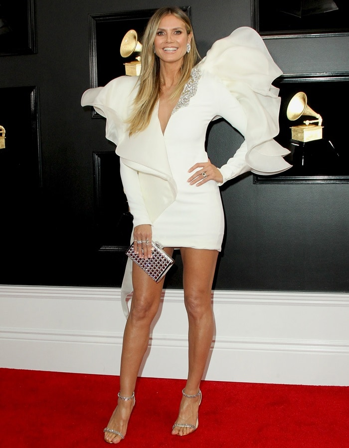 Heidi Klum flaunted her legs in Jimmy Choo heels