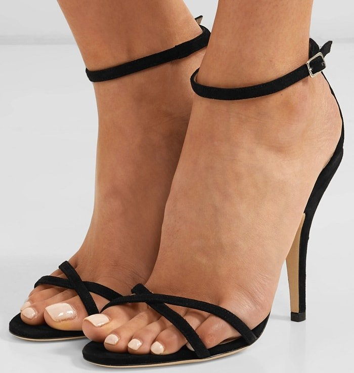 Made in Italy from plush black suede, these 'Ireland' sandals have slim barely-there straps that flatteringly frame the foot