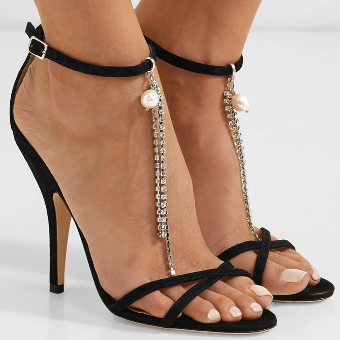 These sandals are set on high heels and come with a detachable faux pearl and crystal charm