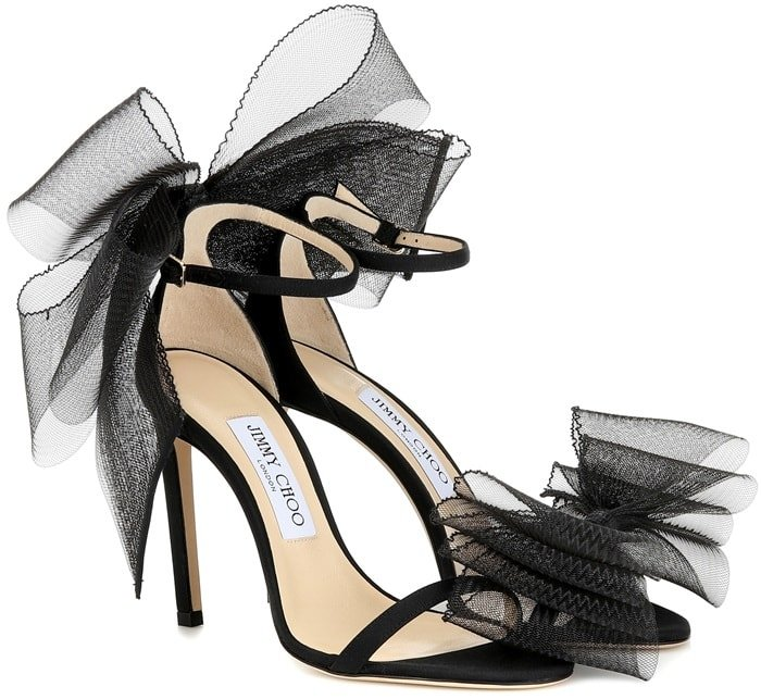 The Italian-made pair has been designed with a black grosgrain ribbon heel, upper and straps for a timelessly elegant look, while the exaggerated hand-tied bows bring a decisively contemporary inflection