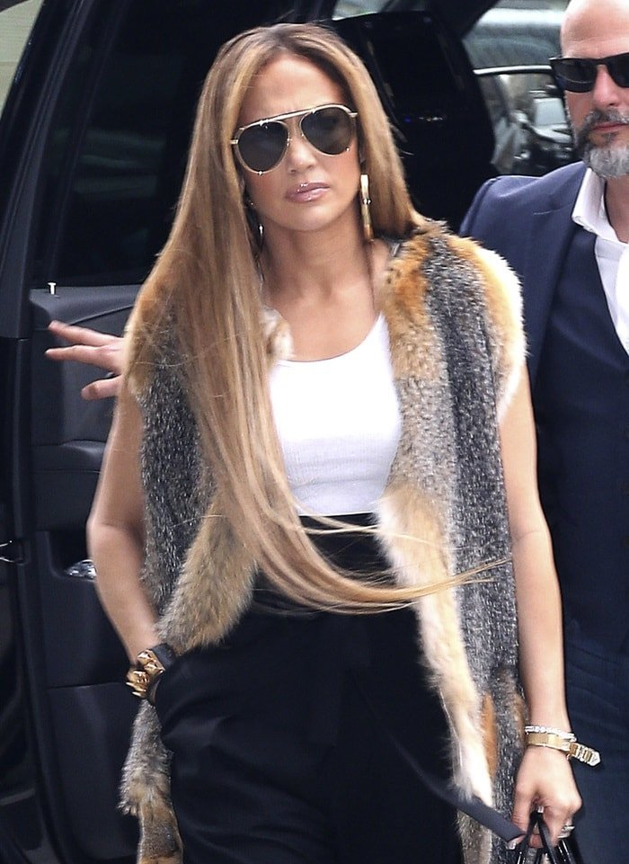 Jennifer Lopez makes her way out of The Elvis Duran Z100 Morning Show studios in New York City on April 9, 2019
