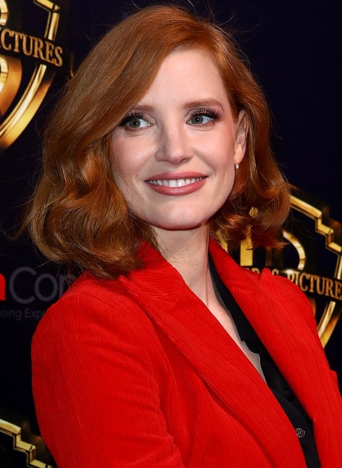 Jessica Chastain wearing Bella Freud's 'Bianca' blazer updated in a vibrant red hue for the new season