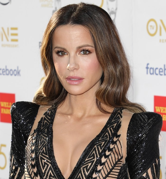 Kate Beckinsale's brunette hair styled in glossy waves