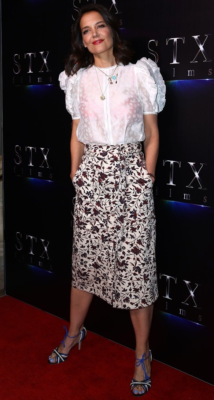"Katie Holmes flashed her legs in a floral Ulla Johnson ""Tegan"" skirt and white top from the same brand"