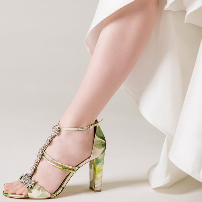 Step out in glamorous floral style with this block-heel sandal featuring sparkling crystals along the T-straps