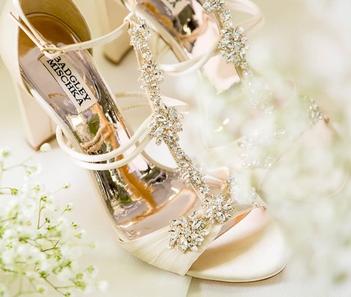 Step out in glamorous nude style with this block-heel sandal featuring sparkling crystals along the T-straps