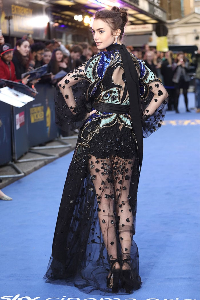 Back view of Lily Collins' Elie Saab Fall 2019 sheer gown featuring heart hands sequined embroidery