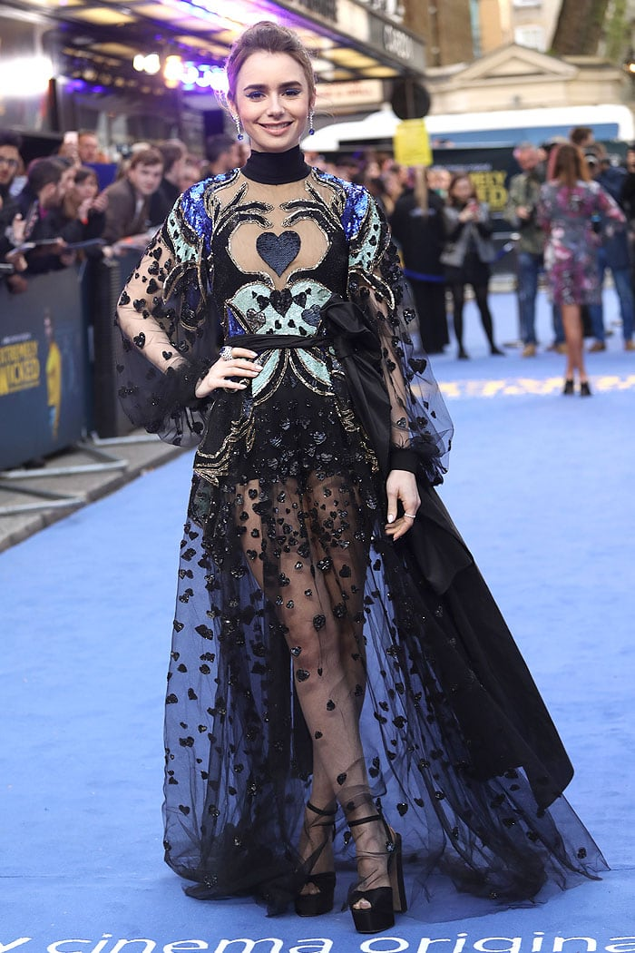 Lily Collins in an Elie Saab heart-sequined sheer gown and Giuseppe Zanotti Double Betty sandals