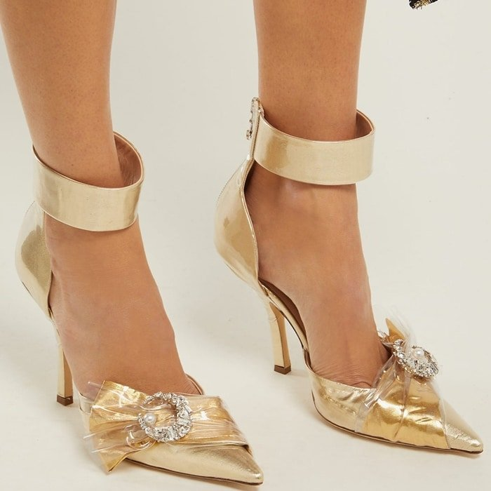These gold lamé pumps are made in Italy with a pointed toe and a wide ankle strap