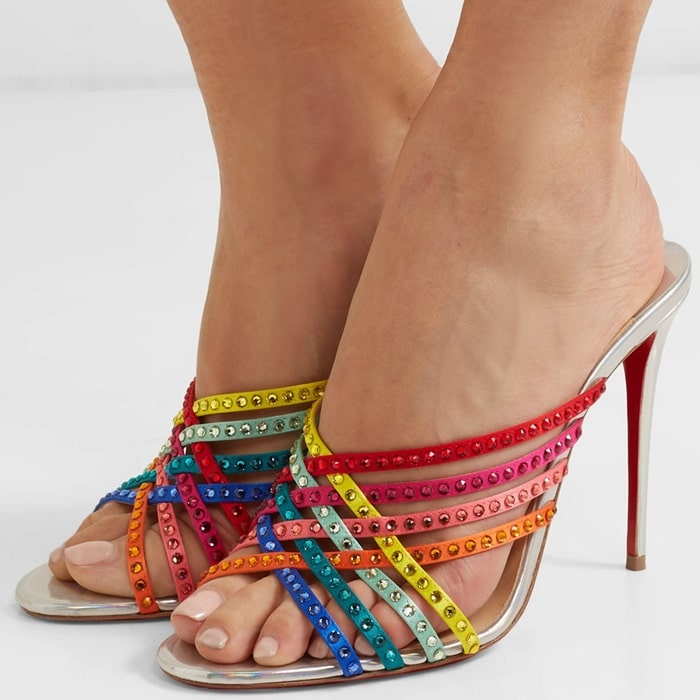 A great starting point for any outfit, Christian Louboutin's 'Marthastrass' mules have been made in Italy from iridescent silver leather and have rainbow-hued silk-satin straps which criss-cross over each other