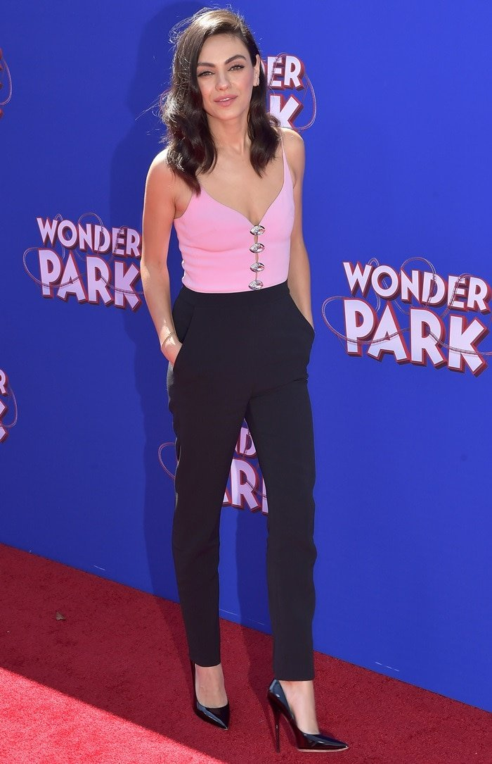 Mila Kunis in pink and black at the premiere of Wonder Park at the Regency Bruin Theatre in Los Angeles on March 10, 2019