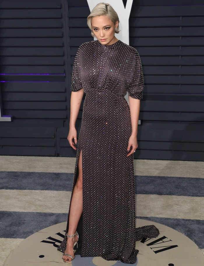 Pom Klementieff flashed her legs in Shiloh sandals at the 2019 Vanity Fair Oscar Party at the Wallis Annenberg Center for the Performing Arts in Beverly Hills, California, on February 24, 2019