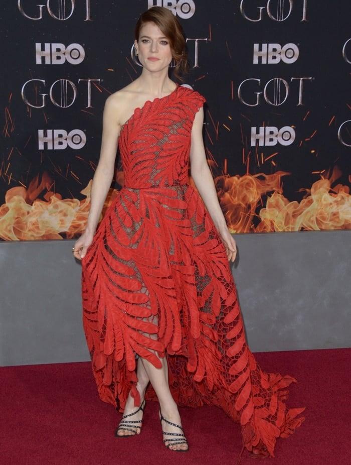 Rose Leslie donned a fiery red Oscar de la Renta asymmetrical dress