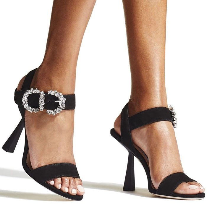 Crafted in Italy, these black goat suede Sereno 100 sandals from Jimmy Choo feature a toe strap, an ankle strap with a crystal baroque buckle, a branded insole and a high kick heel