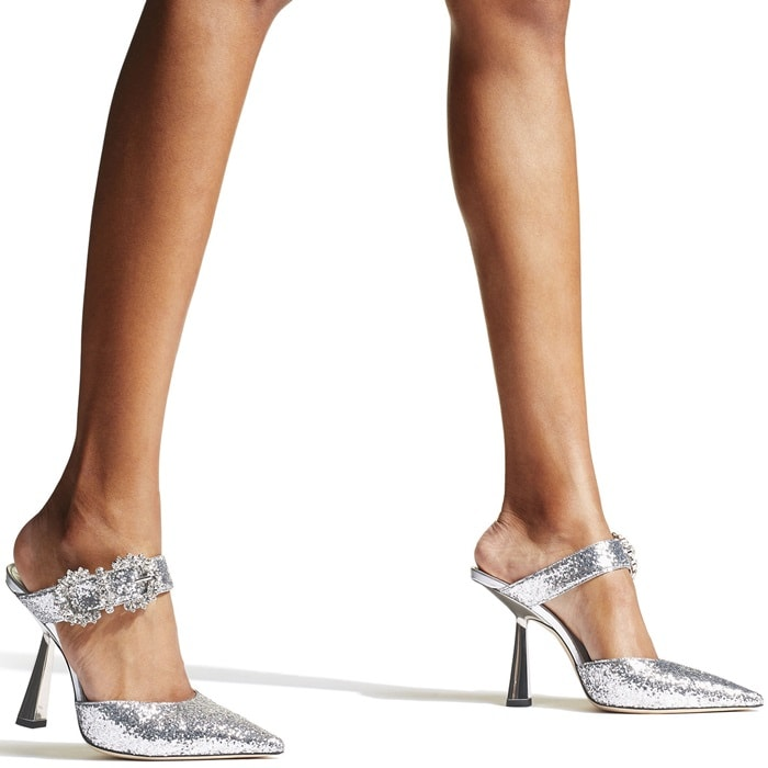 These glittered mules decorated with glistening crystal buckles are the perfect choice for every cocktail hour to come