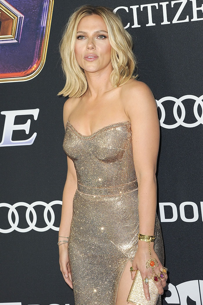 Scarlett Johansson wearing a custom Atelier Versace gold strapless chainmail dress and an Infinity Stones hand jewelry
