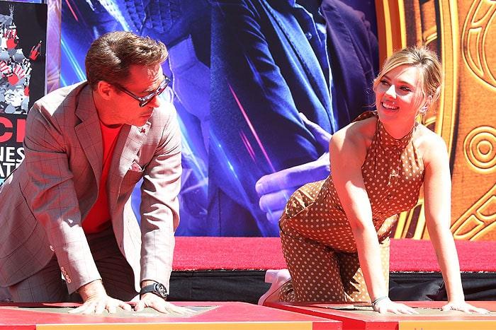 Scarlett Johansson casting her handprint