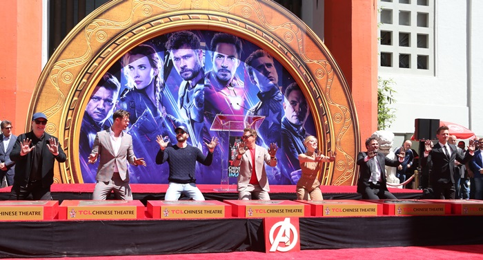 Kevin Feige, Chris Hemsworth, Chris Evans, Robert Downey Jr., Scarlett Johansson, Mark Ruffalo, and Jeremy Renner at their handprint ceremony at the TCL Chinese Theater in Hollywood on April 23, 2019