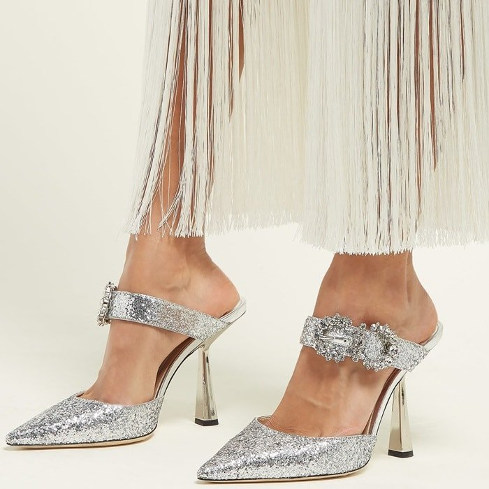 Made in Italy, this pointy pair is decorated with glistening crystal buckles and lined with smooth leather for comfort