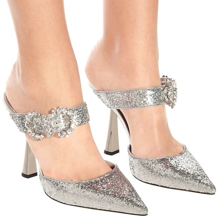 Dial up the drama by slipping on Jimmy Choo's silver Smokey 100 mules, which dazzle with crystal-embellished buckles and a coarse glitter finish