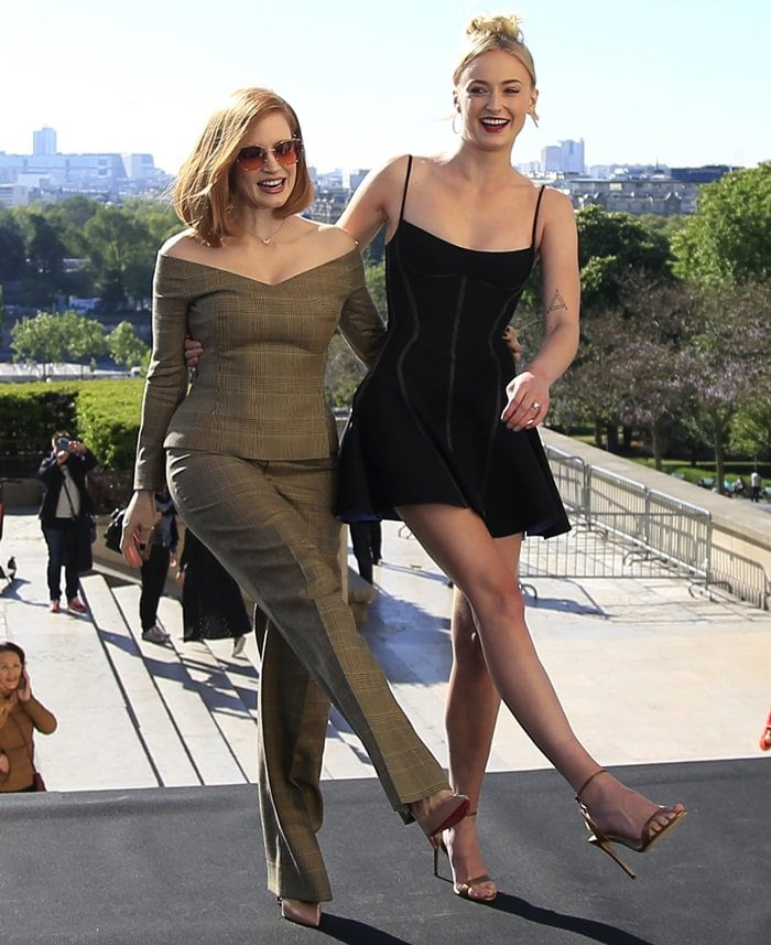 Sophie Turner, joined by Jessica Chastain, flaunted her legs in a black mini dress