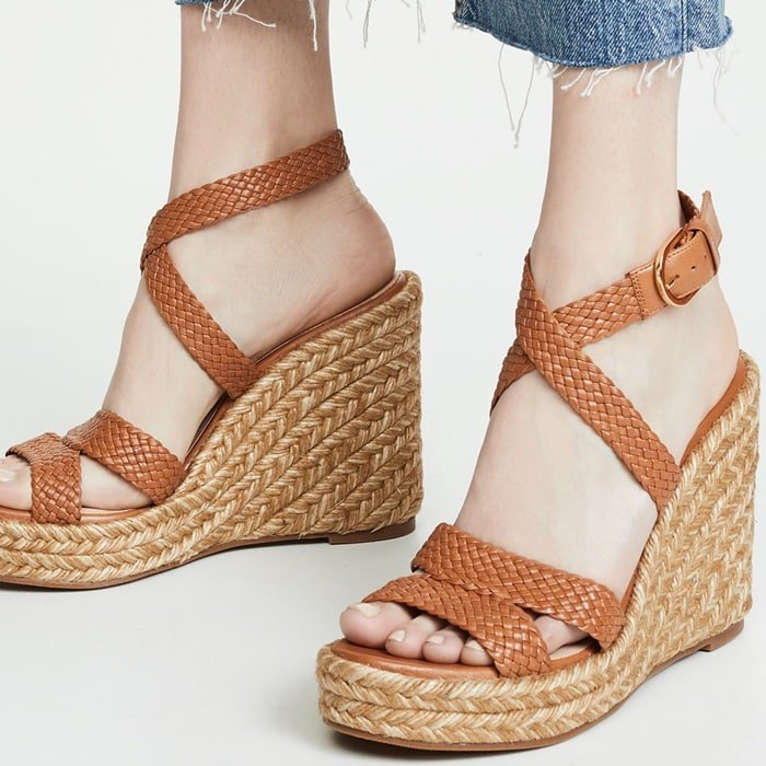 These sandals are further refined by woven leather straps that wrap around the ankle