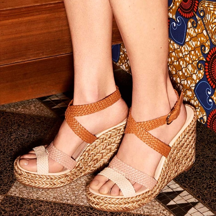 This wedge style has been crafted in Spain with a braided leather upper, which wraps around the ankle for a foot-framing finish, and comes set on a braided jute sole