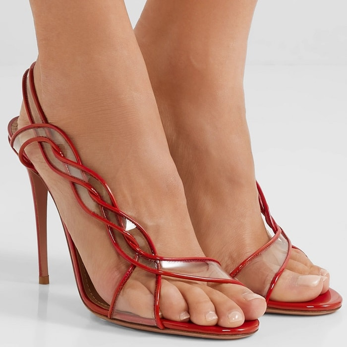 Crafted from glossy red patent-leather, this 'Swing' pair has braided straps inlaid with clear PVC that wrap up the side of your foot to a slingback strap