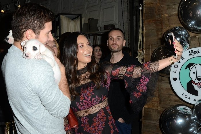 Olivia Munn takes a selfie with Tucker Roberts, the son of Comcast's current president and grandson of the company's founder