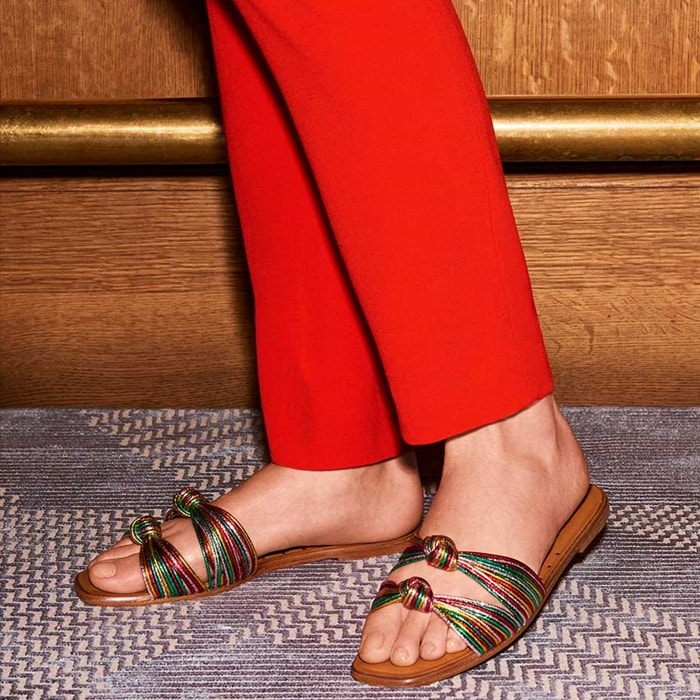 Nautical-inspired knots adorn the Gemma Sandal, made modern by a minimal silhouette and shimmering finish