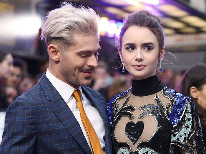 Zac Efron stealing a glance at Lily Collins and her exquisite dress