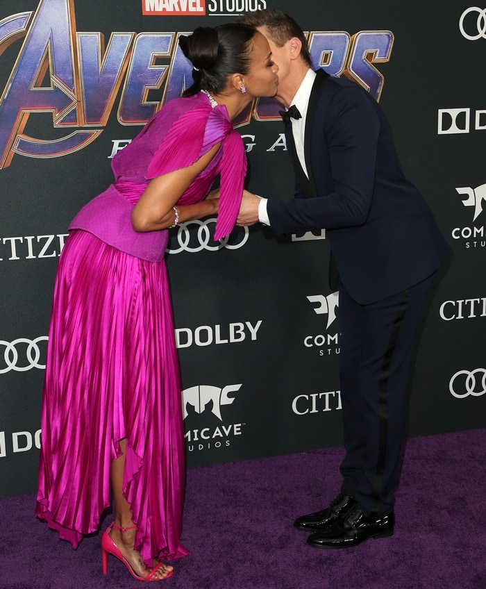 Zoe Saldana gets a kiss from Jeremy Renner at the Avengers: Endgame premiere