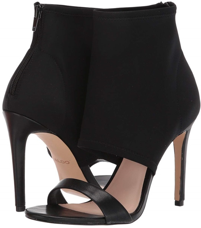 A tall stiletto heel and bootie-inspired silhouette push a peep-toe high heel caged sandal into sophisticated territory