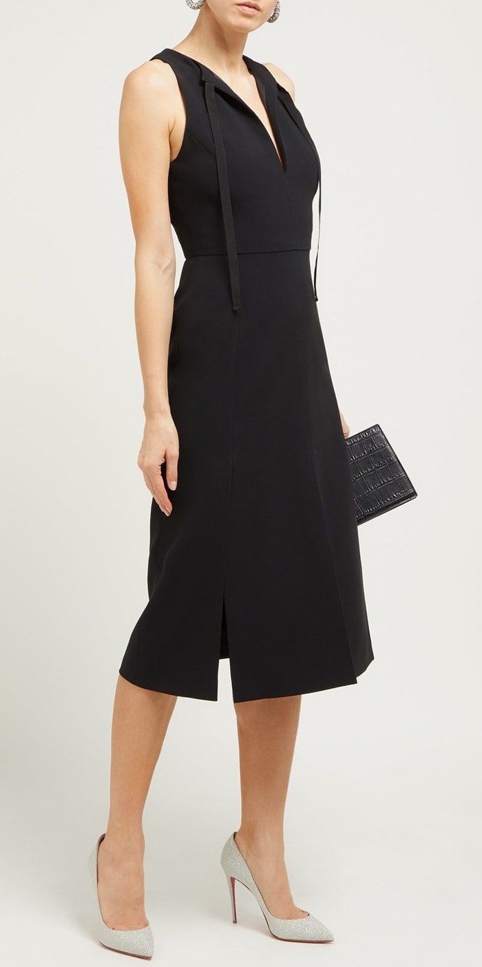 Altuzarra's figure-flattering silhouettes are demonstrated with the refined cut of this black crepe Margherita dress
