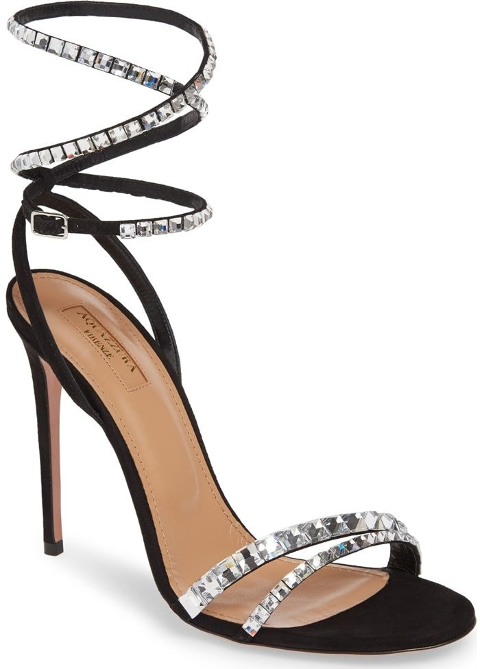 Bejeweled straps bring sparkle to this stiletto-heeled sandal, catching the light—and the eye—with every elegant step