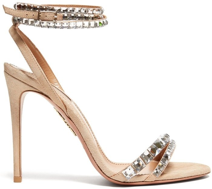 Imbued with timeless elegance for after-dark dressing, these nude sandals are accented with sparkling crystals on the straps and lined in smooth tan leather