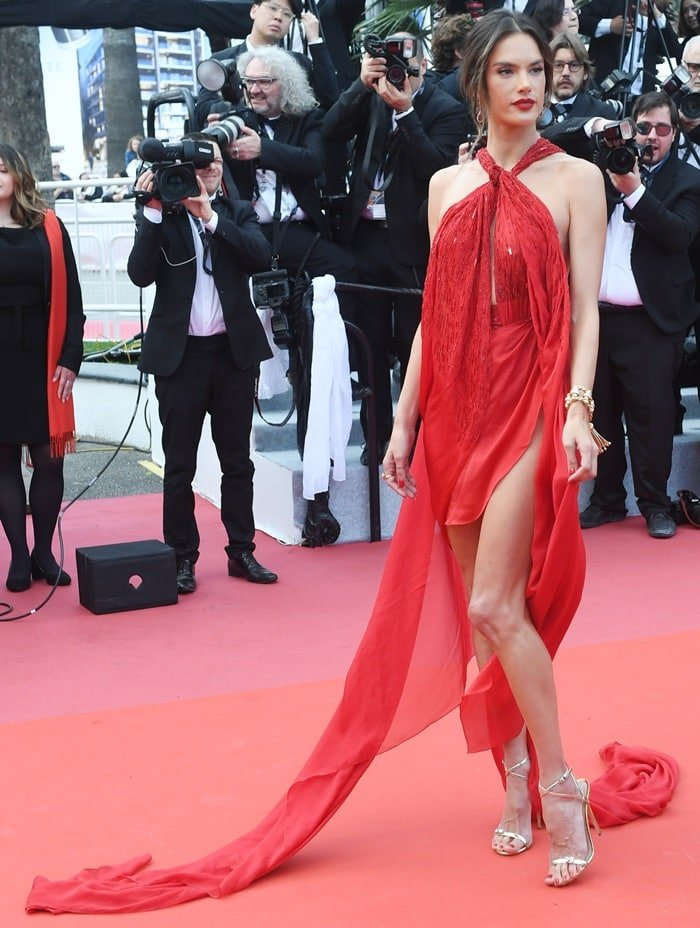 Alessandra Ambrosio flashed her legs in a scarlet red, embroidered silk chiffon dress