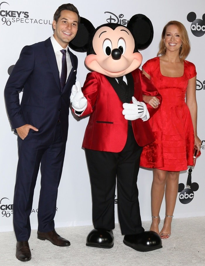 Anna Camp and Skylar Astin attending Mickey's 90th Spectacular celebration