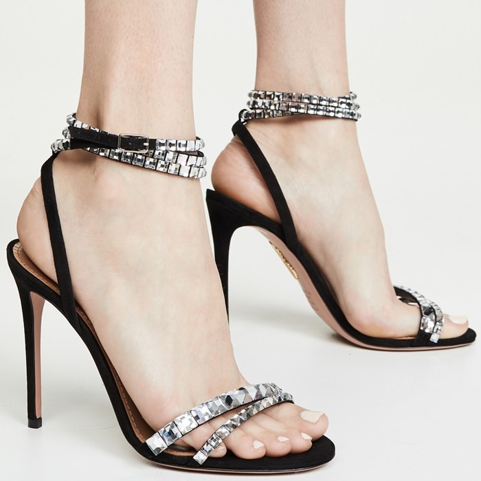 The shimmering crystal-embellished straps keep feet secure