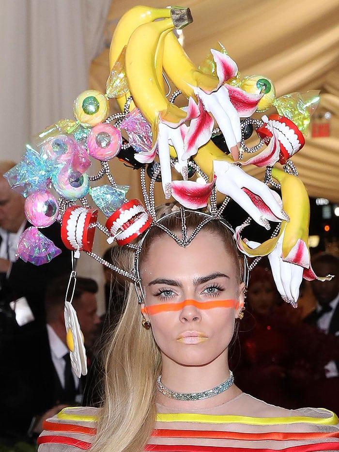 Cara Delevingne wearing a crazy banana teeth headpiece