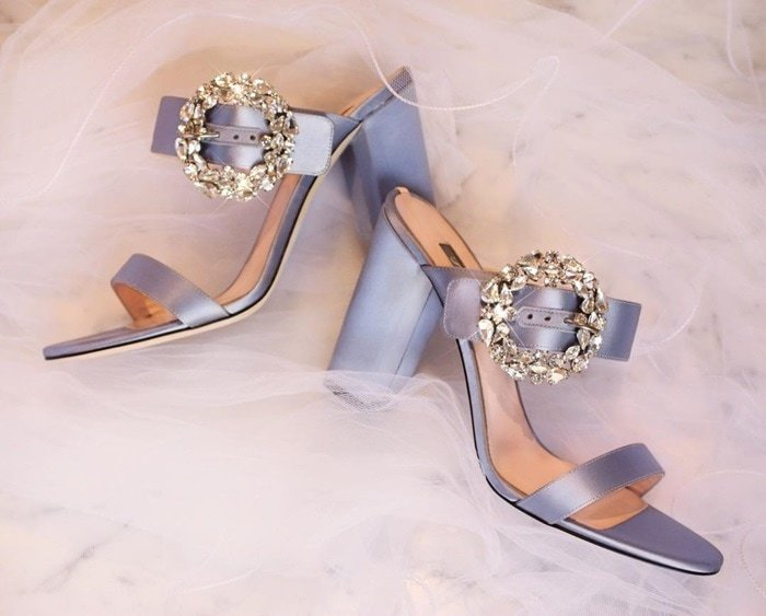 A stunning block-heel sandal in an icey-blue satin