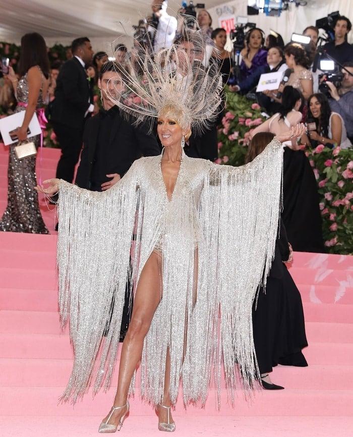 Celine Dion wears a glitzy performance mammoth headdress by Oscar de la Renta at the 2019 Met Gala