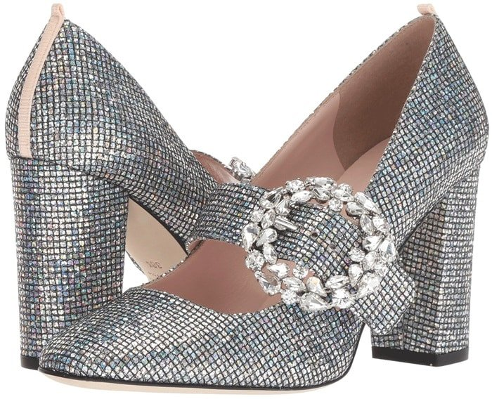 Glittered block heels flaunt a jeweled brooch accent