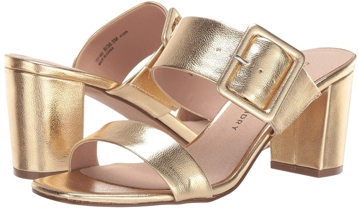 Wide straps and a bold buckle amplify the modern appeal of this block-heel sandal