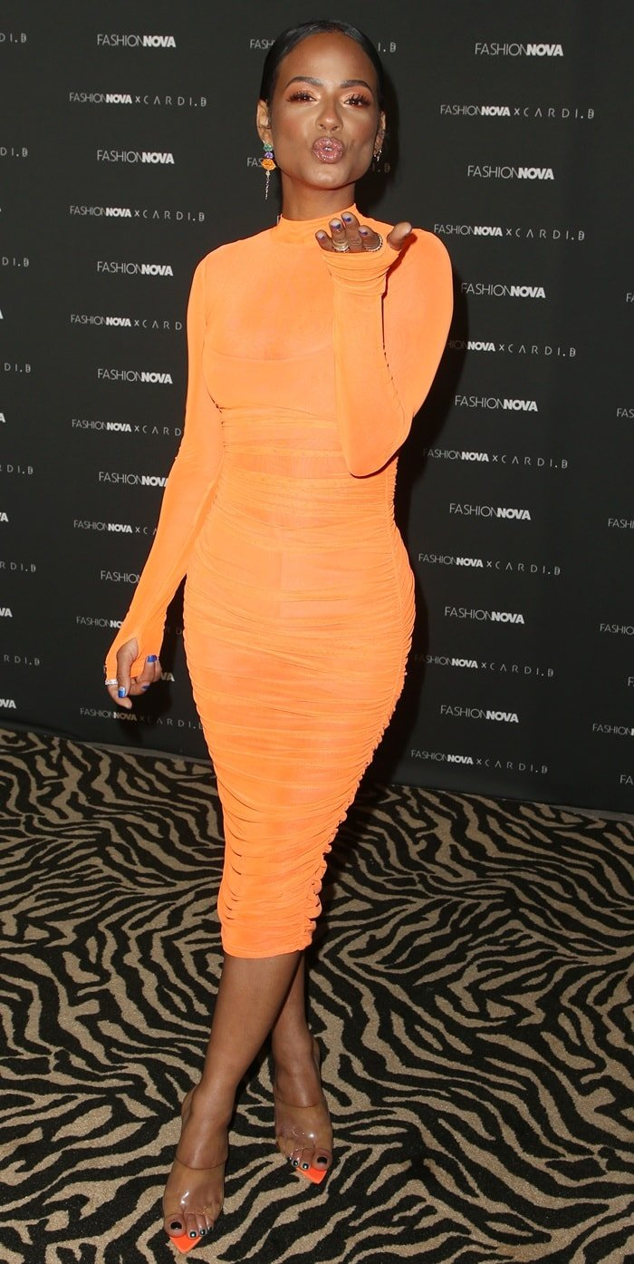 Christina Milian flaunted her legs on the carpet at Fashion Nova Presents: Party with Cardi